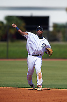 GCL Tigers shortstop Adrian Alfaro (49) warmup throw to first during the first game of a doubleheader against the GCL Yankees 1 on August 5, 2015 at Tigertown in Lakeland, Florida.  GCL Tigers derated the GCL Yankees 5-2.  (Mike Janes/Four Seam Images)