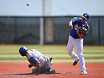 Former Wildcat Kevin Taylor turns a double play past Wildcat Corey Pool during the alumni game at Western Nevada College in Carson City, Nev., on Saturday, Sept. 7, 2013.  <br /> Photo by Cathleen Allison