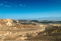 "The Negev Desert contains 60 percent of Israel's total land but less than 10 percent of its population. In Hebrew it Negev means ""parched."" Throughout the desert the dusty plain is slashed and scared by dried-up riverbeds known as wadis."