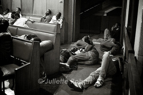 Refugees inside Central Church, waiting for the evening mass or sleeping in the alleys.<br /> April 2009