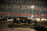 A protester prepares himself to sleep on a bench in Gazi park of Taksim Square during a 24/7 masive rally against the turkish government in Istanbul, Turkey.