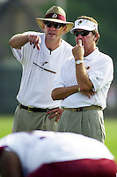 Assistant offensive line coach John Hunt, left confers with new head coach Steve Spurrier, right  on opening day of the Washington Redskins training camp Tuesday July 23, 2002 in Carlisle, Pa. (AP Photo/Brad C Bower)