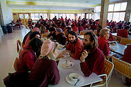 Wasco, Oregon, January 1984: Disciples of Bhagwan Rajneesh, having a meal together in the community lunchroom.  Rajneeshpuram, was an intentional community in Wasco County, Oregon, briefly incorporated as a city in the 1980s, which was populated with followers of the spiritual teacher Osho, then known as Bhagwan Shree Rajneesh. The community was developed by turning a ranch from an empty rural property into a city complete with typical urban infrastructure, with population of about 7000 followers.