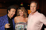 "From left: Little Jewford with Amy and John McCall at a reception held after a reading of ""Becoming Kinky: The World According to Kinky Friedman"" at the Stages Repertory Theater Friday Aug. 13,2010.(Dave Rossman/For the Chronicle)"