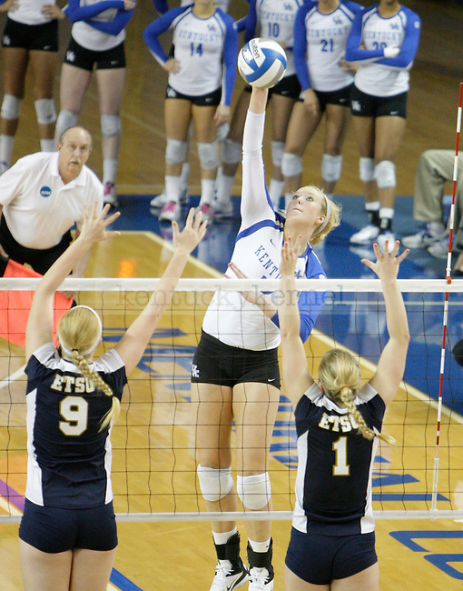 Sophomore Lauren O'Conner (12) spikes the ball during the UK women's volleyball game v. East Tennessee University during the NCAA tournament in Memorial Coliseum in Lexington, Ky., on Friday, November 30, 2012. Photo by Genevieve Adams | Staff