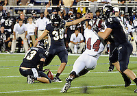 Florida International University football player kicker Jack Griffin (38) kicks the game-winning field goal against Troy University on October 26, 2011 at Miami, Florida. FIU won the game 23-20 in overtime. .