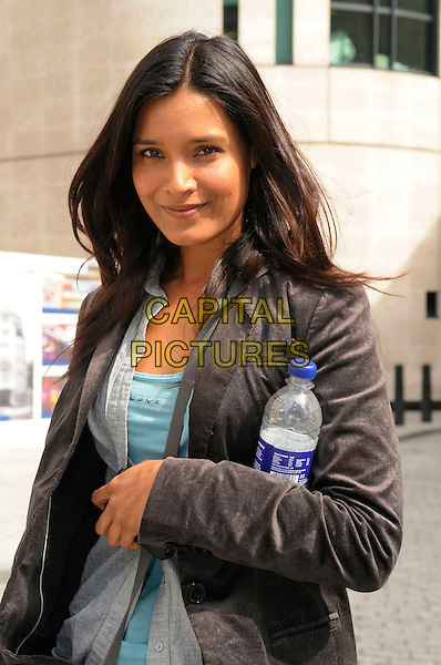 SHELLEY CONN .leaving BBC Radio 4, London, England, UK, April 16th 2011..half length grey gray jacket portrait blue top holding bottle of water .CAP/IA.©Ian Allis/Capital Pictures.