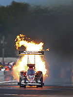 Aug. 18, 2013; Brainerd, MN, USA: NHRA top fuel dragster driver Spencer Massey has a fire during the Lucas Oil Nationals at Brainerd International Raceway. Mandatory Credit: Mark J. Rebilas-