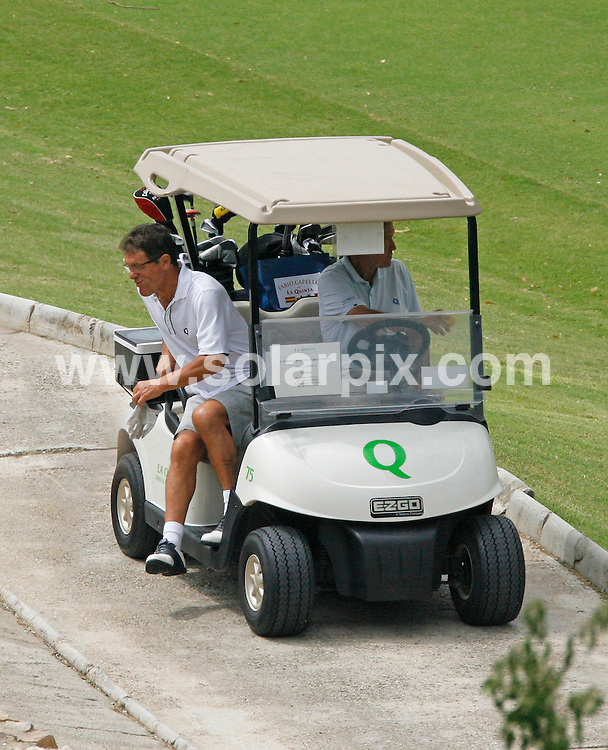 **ALL ROUND EXCLUSIVE PICTURES FROM SOLARPIX.COM**.**WORLDWIDE SYNDICATION RIGHTS**.England football manager Fabio Capello playing in The Sevillano Ballersteros Cancer Foundation Charity championship at La quinta Golf Course in Marbella Spain...This pic: Fabio Capello...JOB REF: 11805       AB1       DATE: 31.07.2010.**MUST CREDIT SOLARPIX.COM OR DOUBLE FEE WILL BE CHARGED**.**MUST AGREE FEE BEFORE ONLINE USAGE**.**CALL US ON: +34 952 811 768 or LOW RATE FROM UK 0844 617 7637**