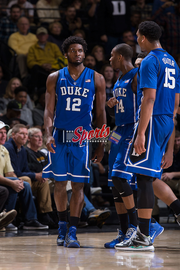 Justise Winslow (12) of the Duke Blue Devils is greeted by teammates Rasheed Sulaimon (14) and Jahlil Okafor (15) after scoring a basket during second half action against the Wake Forest Demon Deacons at the LJVM Coliseum on January 7, 2015 in Winston-Salem, North Carolina.  The Blue Devils defeated the Demon Deacons 73-65.  (Brian Westerholt/Sports On Film)