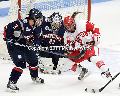 Kiana Nauheim (UConn - 3), Alexandra Garcia (UConn - 83), Kayla Tutino (BU - 8) - The Boston University Terriers defeated the visiting University of Connecticut Huskies 4-2 on Saturday, November 19, 2011, at Walter Brown Arena in Boston, Massachusetts.