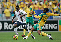 USA's Freddy Adu skips past South Africa's Macbeth Sibaya during first half action between the national teams of South Africa (RSA) and the United States (USA) in an international friendly dubbed the Nelson Mandela Challenge at Ellis Park Stadium in Johannesburg, South Africa on November 17, 2007.