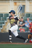Tate Blackman (20) of the Kannapolis Intimidators follows through on his swing against the Hagerstown Suns at Kannapolis Intimidators Stadium on May 4, 2018 in Kannapolis, North Carolina.  The Intimidators defeated the Suns 11-0.  (Brian Westerholt/Four Seam Images)