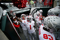 Ohio State Buckeyes wide receiver Johnnie Dixon III (1) and Ohio State Buckeyes defensive end Chase Young (2) high five fans as they enter the field prior to the NCAA football game against the Michigan State Spartans at Spartan Stadium in East Lansing, Mich. on Nov. 10, 2018. [Adam Cairns/Dispatch]