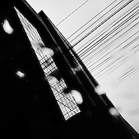 A tower building seen through the taxi window during a heavy rain in Quito, Ecuador, 30 October 2013.