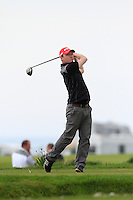 Eoin Arthurs (Firrest Little) on the 1st tee during round 2 of The West of Ireland Amateur Open in Co. Sligo Golf Club on Saturday 19th April 2014.<br /> Picture:  Thos Caffrey / www.golffile.ie