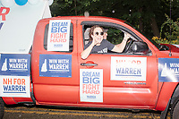 Supporters of Democratic presidential candidate and Massachusetts senator Elizabeth Warren take part in the Labor Day Parade in Milford, New Hampshire, on Mon., September 2, 2019. Candidates Bernie Sanders and Vermin Supreme were the only candidates who marched in the parade this year.