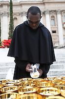 Un frate prepara le ostie per la cerimonia di canonizzazione di Papa Giovanni XXIII e Papa Giovanni Paolo II in Piazza San Pietro, Citta' del Vaticano, 27 aprile 2014.<br /> A friar prepares hosts for the ceremony for the canonization of Pope John XXIII and Pope John Paul II in St. Peter's square at the Vatican, 27 April 2014.<br /> UPDATE IMAGES PRESS/Isabella Bonotto<br /> <br /> STRICTLY ONLY FOR EDITORIAL USE