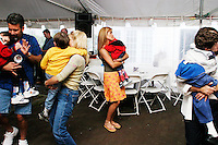Parents dance with their children at the Share and Care Network's annual retreat held in Montauk, NY on May 14, 2004.