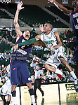 North Texas Mean Green guard Dominique Johnson (1) drives past South Alabama Jaguars guard/forward Gary Redus (2) during the NCAA  basketball game between the South Alabama Jaguars and the University of North Texas Mean Green at the North Texas Coliseum,the Super Pit, in Denton, Texas. UNT defeated South Alabama 82 to 79...
