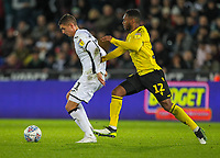 23rd November 2019; Liberty Stadium, Swansea, Glamorgan, Wales; English Football League Championship, Swansea City versus Millwall; Kristoffer Petersen of Swansea City controls the ball despite the pressure from Mahlon Romeo of Millwall - Strictly Editorial Use Only. No use with unauthorized audio, video, data, fixture lists, club/league logos or 'live' services. Online in-match use limited to 120 images, no video emulation. No use in betting, games or single club/league/player publications