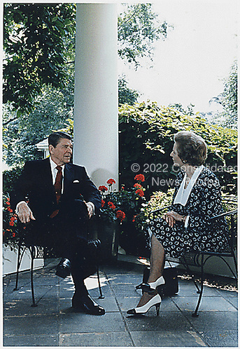 Washington, DC - July 17, 1987 -- United States President Ronald Reagan and Prime Minister Margaret Thatcher of Great Britain meet on the Collonnade outside the Oval Office at the White House in Washington, DC on July 17, 1987..Credit: White House via CNP