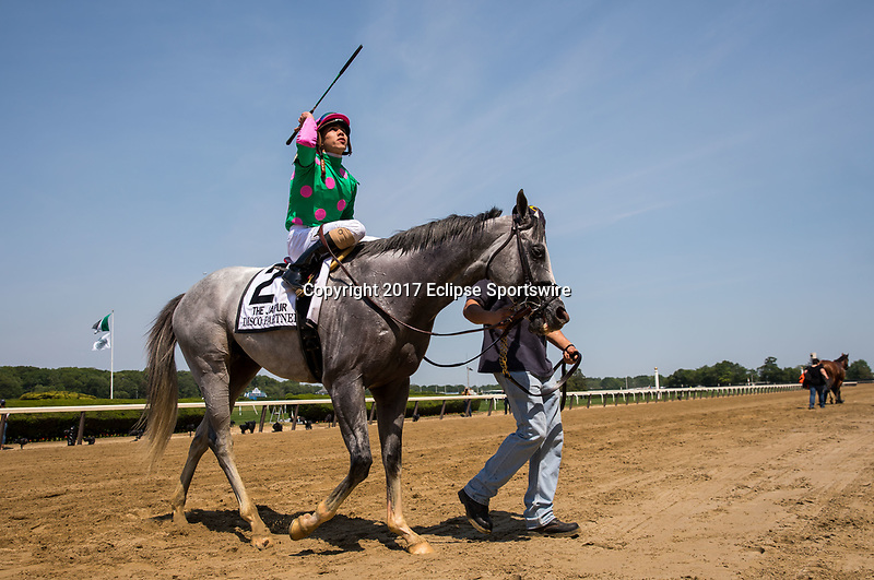 ELMONT, NY - JUNE 10: Irad Ortiz Jr., aboard Disco Partner #2, after winning the Jaipur Invitational Stakes on Belmont Stakes Day at Belmont Park on June 10, 2017 in Elmont, New York (Photo by Jesse Caris/Eclipse Sportswire/Getty Images)