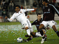 LA Galaxy forward Carlos Ruiz (20) is tripped up by Colorado Rapids defender Ciaran O'Brian (19) during an MLS regular season match at Dicks Sporting Goods Park in Commerce City, Colorado on March 29, 2008. The Rapids defeated the Galaxy 4-0.
