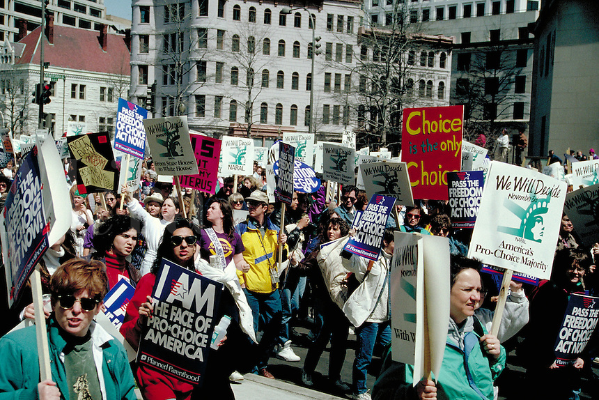 Crowd scene of signholders at a Pro Choice March and Rally on Pennsylvania Avenue in Washington, D.C. abortion, protest, politics, women, rights, power, demonstrations, political activism, protesters. Washington, District of Columbia.