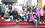 Laura Heywood, aka @BroadwayGirlNYC, with Tonya Pinkins, Michael Park, Anthony Rosenthal and fellow huggers attend Big Hug Day: Broadway comes together to spread kindness and raise funds for Children's Hospitals on January 21, 2018 at Duffy Square, Times Square in New York City.