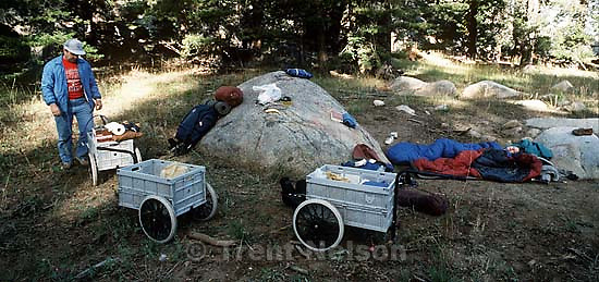 Steve Nelson and Laura Nelson with carts at our stopping point, Resting Rock, on the way to Sword Lake<br />