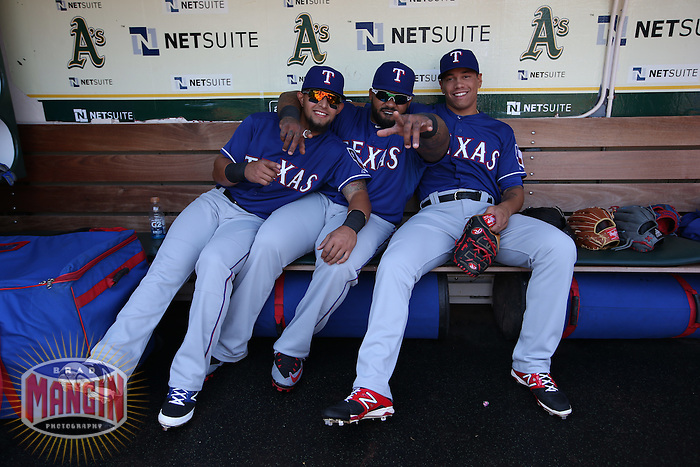 OAKLAND, CA - APRIL 9:  Rougned Odor #12, Prince Fielder #84 and Keone Kela #50 of the Texas Rangers sit in the dugout before the game against the Oakland Athletics at O.co Coliseum on Thursday, April 9, 2015 in Oakland, California. Photo by Brad Mangin