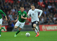 29.05.2013 London, England. James McCarthy, Republic of Ireland, in action against  Wayne Rooney, England, during the International Friendly between England and Republic of Ireland from Wembley Stadium.