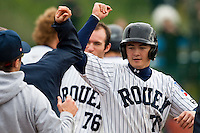 10 october 2009: Kenji Hagiwara of Rouen is congratulated by his teammates as he scores during game 4 of the 2009 French Elite Finals won 7-2 by Huskies of Rouen over Lions of Savigny, at Stade Jean Moulin stadium in Savigny sur Orge, near Paris, France. Rouen wins the 2009 France championship, his sixth title.