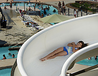NWA Democrat-Gazette/BEN GOFF @NWABENGOFF<br /> Visitors enjoy the slides on Sunday Sept. 6, 2015 at the Rogers Aquatic Center. The water park will be open for the last day of the 2015 season on Monday from 11:00a.m. to 7:00p.m.