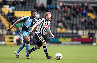 Adam Campbell of Notts County under pressure from Anthony Stewart of Wycombe Wanderers during the Sky Bet League 2 match between Notts County and Wycombe Wanderers at Meadow Lane, Nottingham, England on 28 March 2016. Photo by Andy Rowland.