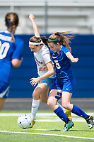 NWA Democrat-Gazette/CHARLIE KAIJO Rogers High School midfielder Hattie Hinkle (5) fights for the ball with Southside High School midfielder Dianna Guerrero (14) during the semifinals of the 7A Girls State Soccer Tournament, Saturday, May 12, 2018 at Whitey Smith Stadium at Rogers High School in Rogers. Rogers advanced to the finals when midfielder Skylurr Patrick (3) scored both of Rogers' goals defeating Southside High School, 2-1.