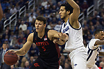 San Diego State forward Yanni Wetzell (5) drives past Nevada forward Johncarlos Reyes (12) during the second half of a basketball game played at Lawlor Events Center in Reno, Nev., Saturday, Feb. 29, 2020. (AP Photo/Tom R. Smedes)