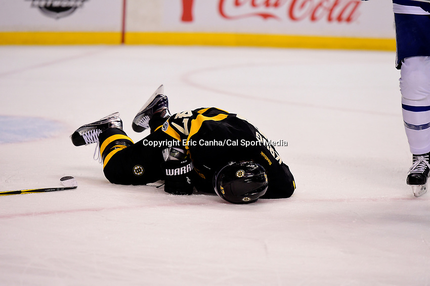 Saturday, February 4, 2017: Boston Bruins defenseman Torey Krug (47) lies on the ice hurt during the National Hockey League game between the Toronto Maple Leafs and the Boston Bruins held at TD Garden, in Boston, Mass. Eric Canha/CSM