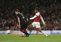 Rennes' Damien Da Silva and Arsenal's Alex Iwobi<br /> <br /> Photographer Rob Newell/CameraSport<br /> <br /> Football - UEFA Europa League Round of 16 Leg 2 - Arsenal v Rennes - Thursday 14th March 2019 - The Emirates - London<br />  <br /> World Copyright © 2018 CameraSport. All rights reserved. 43 Linden Ave. Countesthorpe. Leicester. England. LE8 5PG - Tel: +44 (0) 116 277 4147 - admin@camerasport.com - www.camerasport.com