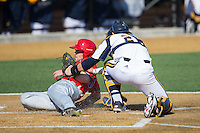 Matt Roth (30) of the Radford Highlanders is tagged out at home plate by Quinnipiac Bobcats catcher Matthew Oestreicher (20) at David F. Couch Ballpark on March 4, 2017 in Winston-Salem, North Carolina.  The Highlanders defeated the Bobcats 4-0.  (Brian Westerholt/Four Seam Images)