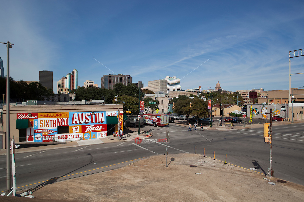 Welcome to Historic Sixth Street mural is the gateway to the famous 6th Street entertainment district with the downtown skyline and State Capitol in the background