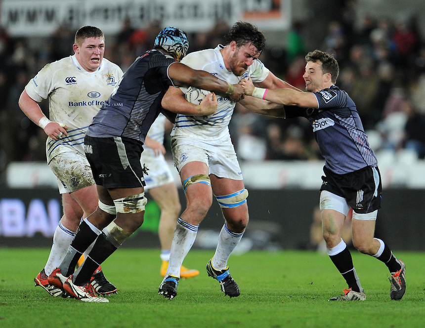 Leinster's Kane Douglas is tackled by Ospreys' Tevita Cavubati and Martin Roberts<br /> <br /> Photographer Ian Cook/CameraSport<br /> <br /> Rugby Union - Guinness PRO12 - Ospreys V Leinster - Friday 27th February 2015 - Liberty Stadium - Swansea<br /> <br /> &copy; CameraSport - 43 Linden Ave. Countesthorpe. Leicester. England. LE8 5PG - Tel: +44 (0) 116 277 4147 - admin@camerasport.com - www.camerasport.com