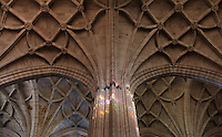 Column meets Ceiling, Gothic choir, 15th century, Segovia Cathedral, (Catedral de Segovia, Catedral de Santa Maria), 1525-77, by Juan Gil de Hontanon (1480-1526), and continued by his son Rodrigo Gil de Hontanon (1500-1577), Segovia, Castile and Leon, Spain. Last Gothic Cathedral in Spain, commissioned by Carlos V (1500-58), after an earlier cathedral was damaged in the Revolt of the Comuneros, 1520. Cathedral consecrated, 1768. Ground plan has three naves surrounded by chapels. The interior is lit by Flemish windows, 16th-17th century, and centres on Gothic choir (15th century). Picture by Manuel Cohen