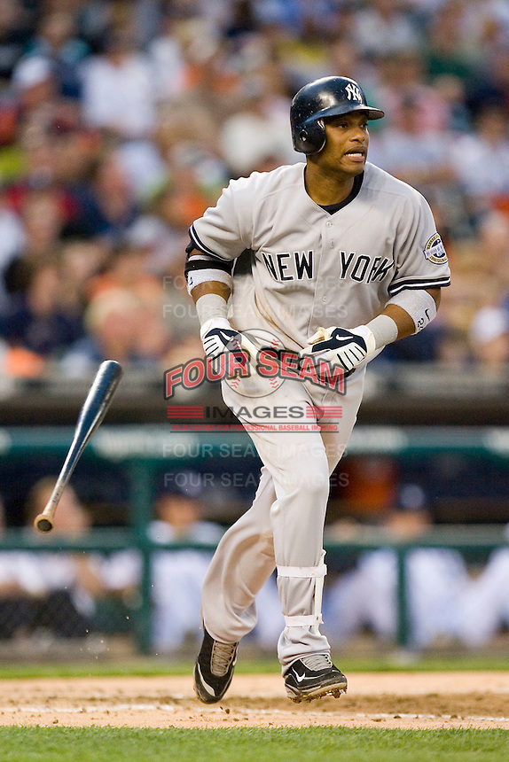 Robinson Cano #24 of the New York Yankees flips his bat as he heads down to the first base line at Comerica Park April 27, 2009 in Detroit, Michigan.  Photo by Brian Westerholt / Four Seam Images