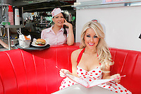 25/8/2011. Waitress Hannah from Sweeden and Model Tiffany Stanley are pictured at the offical opening of the new Eddie Rockets City Diner in Nass Co Kildare. Picture James Horan/Collins Photos