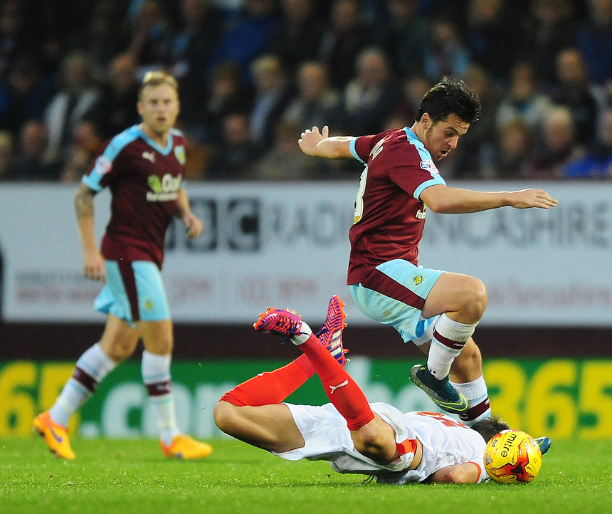 Huddersfield Town&rsquo;s Emyr Huws is fouled by Burnley&rsquo;s Joey Barton<br /> <br /> Photographer Chris Vaughan/CameraSport<br /> <br /> Football - The Football League Sky Bet Championship - Burnley v Huddersfield Town - Saturday 31st October 2015 - Turf Moor - Burnley<br /> <br /> &copy; CameraSport - 43 Linden Ave. Countesthorpe. Leicester. England. LE8 5PG - Tel: +44 (0) 116 277 4147 - admin@camerasport.com - www.camerasport.com