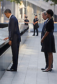 United States President Barack Obama, First Lady Michelle Obama, former U.S. President George W. Bush, and former First Lady Laura Bush visit the North Memorial Pool at Ground Zero on the 10th anniversary of the September 11 terrorist attacks in New York, New York on September 11, 2011. The President and First Lady are attending the Commemoration Ceremony at the National September 11 Memorial at the World Trade Center Site as they visit each of the three sites that were attacked. .Credit: Kristoffer Tripplaar / Pool via CNP