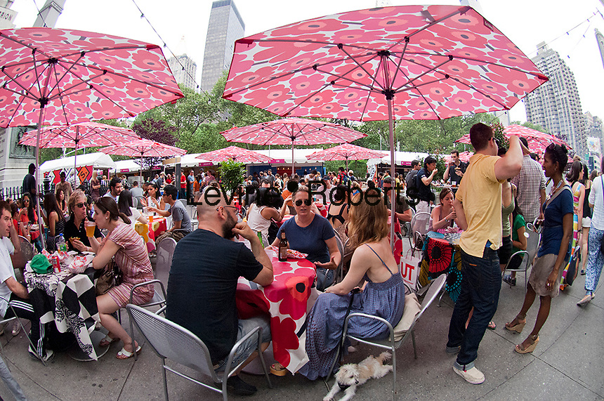 Foodies enjoy the offerings at the Madison Square Eats outdoor market in New York on Sunday, May 27, 2012. The month-long temporary food fair, in Worth Square by Madison Square park,  brings an assortment of restaurants providing an outdoor dining experience attracting food lovers and the after-work crowd. (© Frances M. Roberts)