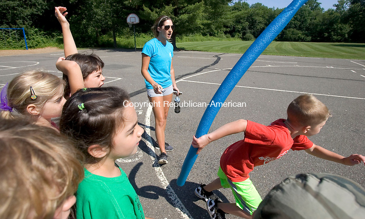 MIDDLEBURY CT. 30 June 2014-063014SV01-Paige Santos of Middlebury, camp councilor, cheers on her team during a pool noodle relay at summer camp at Middlebury Elementary School in Middlebury Monday.<br /> Steven Valenti Republican-American